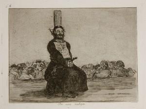 اللوحة 34 كاهن يقبض على صليب بين يديه معلقاً على صدره
